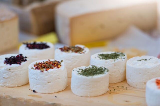 Traditional artisan goat cheese composition with spices and wild